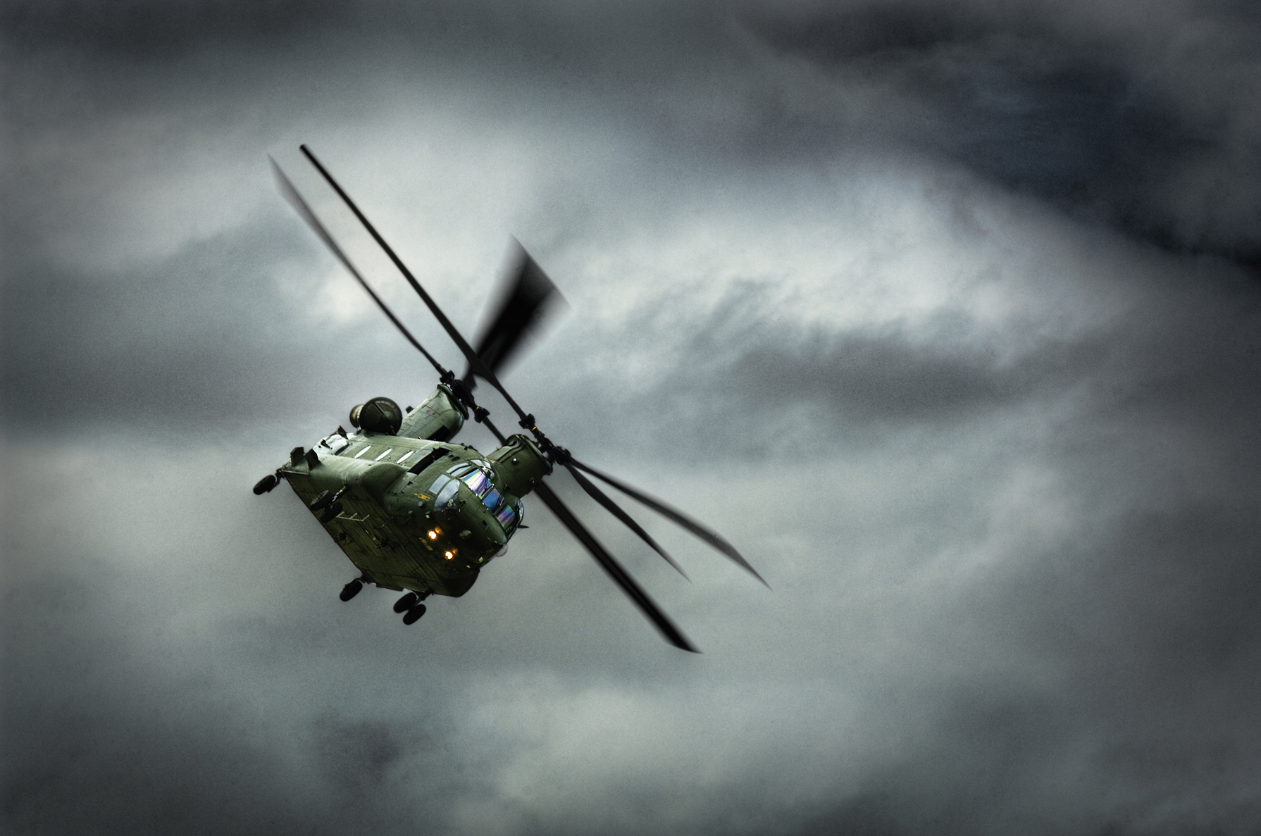 Chinook helicopter in a heavy sky